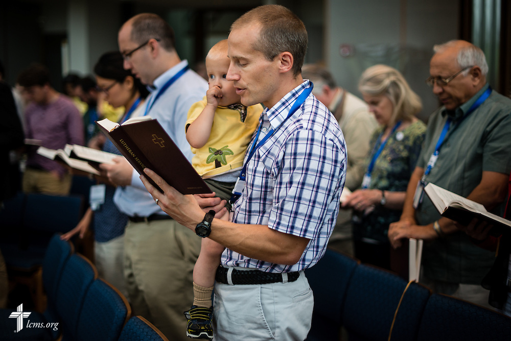 The Rev. Jonathan Clausing, career missionary through The Lutheran Church—Missouri Synod in Eastern Africa, based in Kenya, holds his son Elijah during morning chapel service at the International Center of The Lutheran Church–Missouri Synod on Tuesday, June 23, 2015, in Kirkwood, Mo. LCMS Communications/Erik M. Lunsford