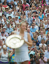 LONDON, ENGLAND - Saturday, July 2, 2011: Spectators take photographs as Petra Kvitova (CZE) shows off the trophy to fans outside the Centre Court clubhouse after winning the Ladies' Singles Final on day twelve of the Wimbledon Lawn Tennis Championships at the All England Lawn Tennis and Croquet Club. (Pic by David Rawcliffe/Propaganda)