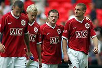 Photo: Paul Thomas.<br /> Chelsea v Manchester United. The FA Cup Final. 19/05/2007.<br /> <br /> Dejected Wayne Rooney (2nd R) and Utd team-mates.