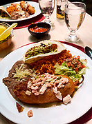 U.S.A., New Mexico. Las Cruces, Mesilla. Peppers New Mexican Cafe & Bar. Seafood Chile Relleno (bay shrimp & scallops, tempura crisp, green sauce) and Shark Tacos (Flour tortillas, crispy fish filet, shredded cabbage, greenchile verde sauce).