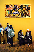 Patrons chat below a piece of artwork in the lobby of SOPAC in South Orange, NJ.