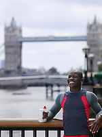 Man drinking water in front of Tower Bridge England London