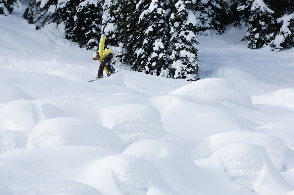 Professional snowboarder Sammy Luebke flies through a pillow field in the Kootenay Mountains of British Columbia, Canada.