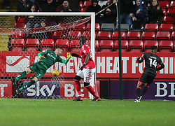 Milton Keynes Dons Kieran Agard scores his sides first goal during the Sky Bet League One match at The Valley, Charlton.