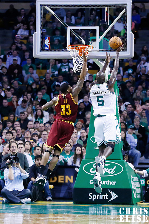 19 December 2012: Boston Celtics power forward Kevin Garnett (5) goes for the layup over Cleveland Cavaliers small forward Alonzo Gee (33) during the Boston Celtics 103-91 victory over the Cleveland Cavaliers at the TD Garden, Boston, Massachusetts, USA.