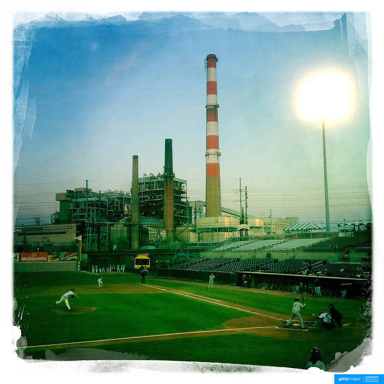 An iPhone Hipstamatic image of the Bridgeport Harbor Power Station which provides a back drop to the ballpark during the Bridgeport Bluefish V Southern Maryland Blue Crabs, Atlantic League, Minor League ballgame at Harbor Yard Ballpark, Bridgeport, Connecticut, USA. Photo Tim Clayton