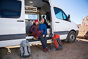 "Portrait of Brittany Griffith & Jonathon Thesenga in their ""Sprinter"" camper van, Indian Creek Canyon, Utah"