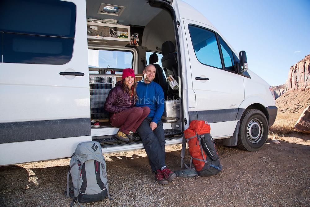 "Portrait of Brittany Griffith & Jonathon Thesenga in their ""Sprinter"" camper van, Indian Creek Canyon, Utah"