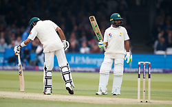 Pakistan's Asad Shafiq, (right) celebrates reaching his 50 during day two of the First NatWest Test Series match at Lord's, London.
