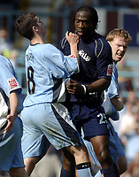 Photo. Glyn Thomas. <br /> Coventry City v Brighton and Hove Albion. <br /> Coca Cola Championship. 02/04/2005.<br /> Coventry's Richard Duffy (L) pushes Brighton's Mark McCammon out of the way after he gets involved in a fracas after Coventry's Michael Doyle sat on top of Brighton's Leon Knight in retaliation after Knight appeared to foul Coventry's Robert Page.