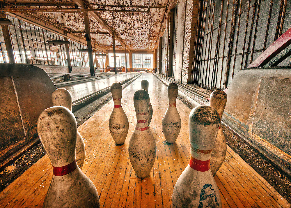 The Abandoned Scranton Lace Company in Scranton PA. A set of old bowling pins sit on an abandoned bowling alley.