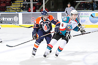 KELOWNA, CANADA, FEBRUARY 11: Dylan Willick #11 of the Kamloops Blazers checks Colten Martin #8 of the Kelowna Rockets  as the Kamloops Blazers visit the Kelowna Rockets on February 11, 2012 at Prospera Place in Kelowna, British Columbia, Canada (Photo by Marissa Baecker/Shoot the Breeze) *** Local Caption ***