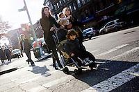 """9 Novembre, 2008. Brooklyn, New York.<br /> <br /> Delle mamme con i relativi figli passeggiano per le vie di Park Slope, Brooklyn, NY. Park Slope, spesso definito dai newyorkesi come """"The Slope"""", è un quartiere nella zona ovest di Brooklyn, New York, e confinante con Prospect Park.  Park Slope è un quartiere benestante che ha il maggior numero di nascite, la qualità della vita più alta e principalmente abitato da una classe media di razza bianca. Per questi motivi molte giovani coppie e famiglie decidono di trasferirsi dalle altre municipalità di New York a Park Slope. Dal punto di vista architettonico, il quartiere è caratterizzato dai brownstones, un tipo di costruzione molto frequente a New York, e da Prospect Park.<br /> <br /> ©2008 Gianni Cipriano for The New York Times<br /> cell. +1 646 465 2168 (USA)<br /> cell. +1 328 567 7923 (Italy)<br /> gianni@giannicipriano.com<br /> www.giannicipriano.com"""