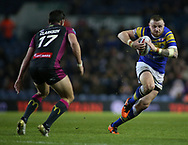 Brad Singleton of Leeds Rhinos on the attack against Chris Clarkson (L) of Hull Kingston Rovers during the Betfred Super League match at Elland Road, Leeds<br /> Picture by Stephen Gaunt/Focus Images Ltd +447904 833202<br /> 08/02/2018