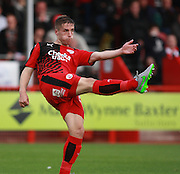 Crawley Town defender Mitch Hancox clears the ball forward during the Sky Bet League 2 match between Crawley Town and Leyton Orient at the Checkatrade.com Stadium, Crawley, England on 10 October 2015. Photo by Bennett Dean.