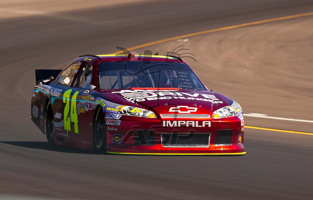AVONDALE, AZ - MAR 03, 2012:  Jeff Gordon (24) brings his NASCAR Sprint Cup car through turn 4 during qualifying for the Subway Fresh Fit 500 race at the Phoenix International Raceway in Avondale, AZ.