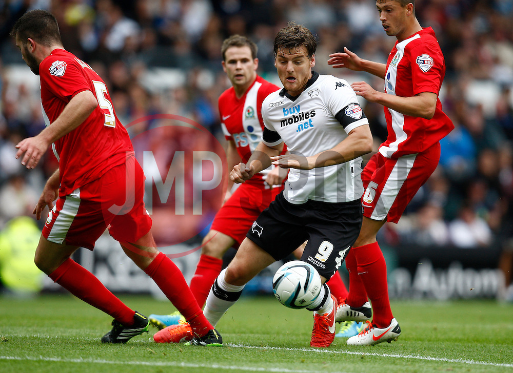 Derby County's Chris Martin cuts inside three defenders - Photo mandatory by-line: Matt Bunn/JMP - Tel: Mobile: 07966 386802 04/08/2013 - SPORT - FOOTBALL -  Pride Park Stadium - Derby -  Derby County v Blackburn Rovers - Sky Bet Championship