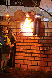 © Licensed to London News Pictures.  02/11/2013. BUCKINGHAMSHIRE, UK. An effigy of prime minister David Cameron and a 60 foot scale model of a HS2 train crossing a bridge is lit as part of the Speen Village annual bonfire and firework display. <br /> <br /> Despite the village not being on the proposed route local residents are strongly opposed to the project as a waste of money. The model was created using recycled materials and was free to make. <br /> <br /> Photo credit: Cliff Hide/LNP