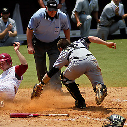 June 05, 2011; Tallahassee, FL, USA; Alabama Crimson Tide third baseman Brett Booth slides past UCF Knights catcher Beau Taylor as he loses the ball while attempting to make a tag at homeplate during the seventh inning of the Tallahassee regional of the 2011 NCAA baseball tournament at Dick Howser Stadium. Alabama defeated UCF 12-5. Mandatory Credit: Derick E. Hingle