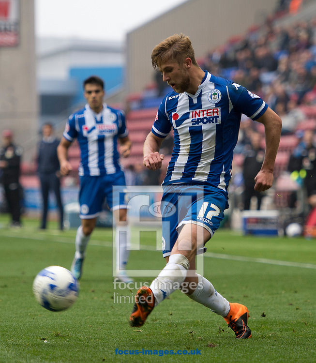 Michael Jacobs of Wigan Athletic puts a cross in during the Sky Bet League 1 match at the DW Stadium, Wigan<br /> Picture by Russell Hart/Focus Images Ltd 07791 688 420<br /> 03/10/2015