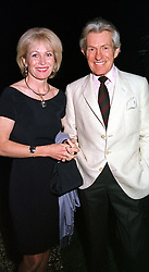 LADY ANNUNCIATA ASQUITH and the EARL OF LICHFIELD,<br />  at a dinner in London on 22nd May 2000.OEK 143