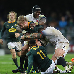 Joe Marler and Maro Itoje of England tackling Pieter-Steph du Toit of South Africa during the 2018 Castle Lager Incoming Series 3rd Test match between South Africa and England at Newlands Rugby Stadium,Cape Town,South Africa. 23,06,2018 Photo by (Steve Haag JMP)