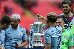Kyle Walker of Manchester City places the lid on the trophy - Mandatory by-line: Arron Gent/JMP - 18/05/2019 - FOOTBALL - Wembley Stadium - London, England - Manchester City v Watford - Emirates FA Cup Final