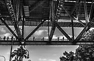 Sydney, Australia -- February 18, 2018. People are walking across the bridge over the Sydney Harbor. Editorial use only.
