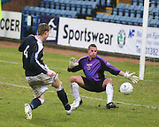 Dundee's Kevin McDonald scores past Clyde goalkeeper David Hutton during the IRN BRU Scottish League First Division match at Dens Park<br /> <br /> ,<br /> Monifieth,<br /> <br /> 0776 5252616