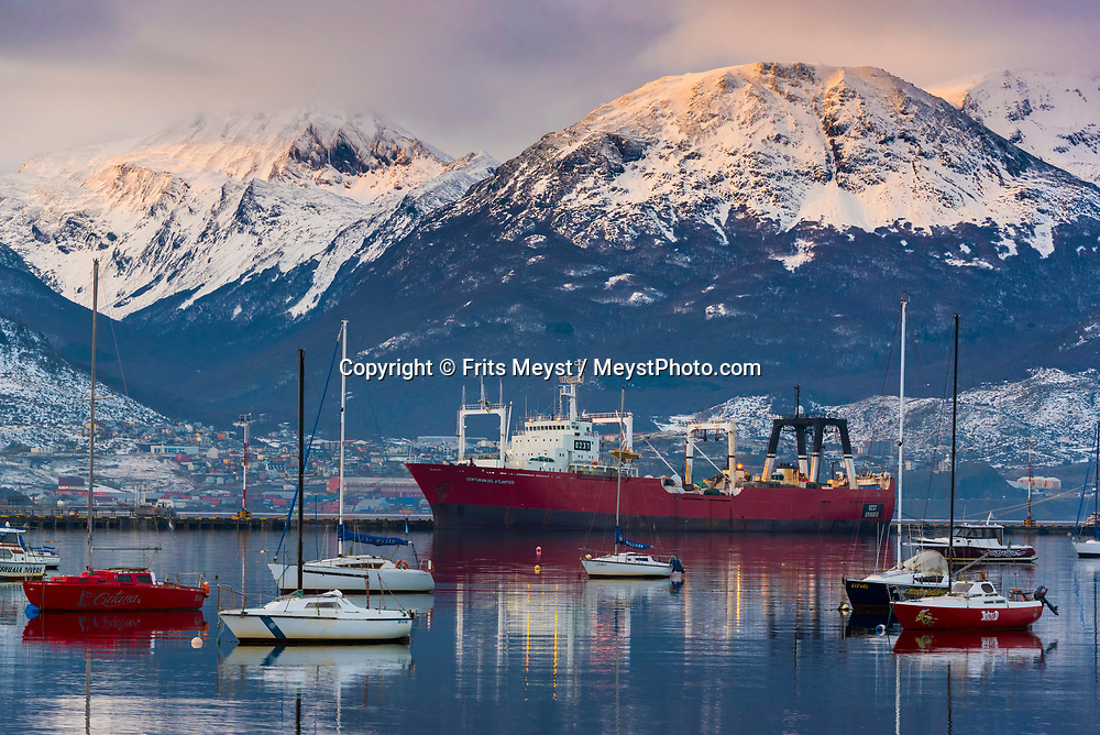Ushuaia, Tierra del Fuego, Argentina, June 2017.  The port of Ushiaia, surrounded by the Southernmost mountain ranges of the Andes, is the most important port of embarkation for expedition and cruise ships to Antarctica.  Photo by Frits Meyst / MeystPhoto.com