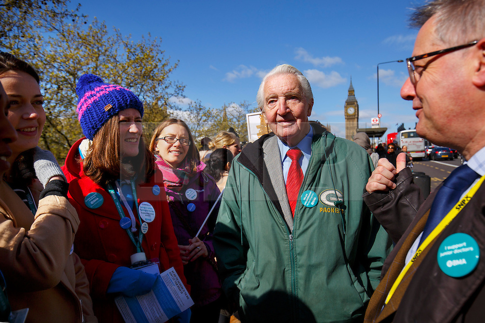 © Licensed to London News Pictures. 26/04/2016. London, UK. Labour MP Dennis Skinner joins junior doctors of St Thomas' Hospital protesting at a picket line as junior doctors in England stage a all-out 48-hours strike for the first time in NHS history in a dispute over pay, working hours and patient safety on Tuesday, 26 April 2016. Photo credit: Tolga Akmen/LNP