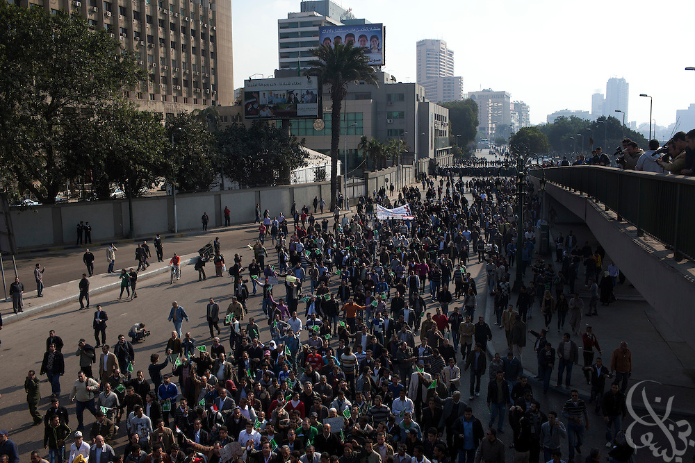 "Thousands of Egyptian protesters march past the ruling National Democratic Party (NDP) headquarters building  during January 25, 2011 ""Day of Anger"" demonstrations in downtown Cairo, Egypt. Today's protests across Egypt, inspired by the revolution in Tunisia, were organized by a wide range of opposition groups and intended to spark a similar movement in Egypt. Credit: Scott Nelson"