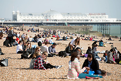 © Licensed to London News Pictures. 29/03/2014. Brighton, UK People enjoy the sunny weather in Brighton today 29th March 2014. The warm weather is forecast to remain into next week. Photo credit : Stephen Simpson/LNP