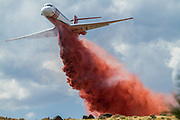 August 23, 2017<br /> A firefighting airplane drops fire retardant on the Mogul Fire in northwest Reno, Nevada, on Wednesday, August 23, 2017. Reports from the Truckee Meadows Fire department, at approximately 4:30 pm, state the fire has burned 120 acres and 10 homes have been evacuated. There has been one heat-related injury. The cause of the fire has not been determined at this time.