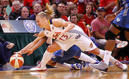 INDIANAPOLIS, IN - OCTOBER 21: Erin Phillips #13 of the Indiana Fever and Monica Wright #22 of the Minnesota Lynx battle for a loose ball during Game Four of the 2012 WNBA Finals on October 21, 2012 at Bankers Life Fieldhouse in Indianapolis, Indiana. NOTE TO USER: User expressly acknowledges and agrees that, by downloading and or using this Photograph, user is consenting to the terms and conditions of the Getty Images License Agreement. (Photo by Michael Hickey/Getty Images) *** Local Caption *** Erin Phillips; Monica Wright