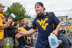 Sep 12, 2015; Morgantown, WV, USA; West Virginia Mountaineers quarterback Skyler Howard arrives at Milan Puskar Stadium before their game against the Liberty Flames. Mandatory Credit: Ben Queen-USA TODAY Sports