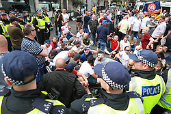 © Licensed to London News Pictures. 10/06/2018. London, UK. Counter protesters sit in the street at the annual Al Quds day march in support of the Palestinian cause, in central London. A counter demonstration by far-right and Zionest groups also takes place. Photo credit: Joel Goodman/LNP