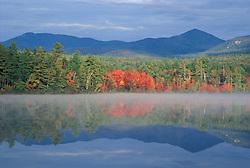 Fall reflections in Chocorua Lake in New Hampshire's White Mountains.  Chocorua, NH