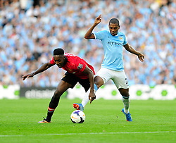 Manchester United's Danny Welbeck is tackled by Manchester City's Fernandinho - Photo mandatory by-line: Dougie Allward/JMP - Tel: Mobile: 07966 386802 22/09/2013 - SPORT - FOOTBALL - City of Manchester Stadium - Manchester - Manchester City V Manchester United - Barclays Premier League
