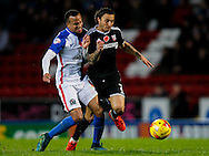 Sam Saunders of Brentford is challenged during the Sky Bet Championship match between Blackburn Rovers and Brentford at Ewood Park, Blackburn<br /> Picture by Mark D Fuller/Focus Images Ltd +44 7774 216216<br /> 07/11/2015