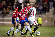 Bonnyrigg White Eagles forward Jaewook Woo (22) tackled by Western Sydney Wanderers midfielder Roly Bonevacia (28) at the FFA Cup Round 16 soccer match between Bonnyrigg White Eagles FC v Western Sydney Wanderers FC at Marconi Stadium in Sydney.