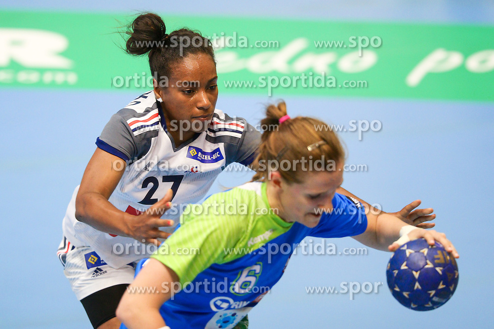 Estelle Nze Minko of France and Ana Gros of Slovenia during handball match between National Teams of Slovenia and France in Qualification of 2015 Women's European Championship, on June 13th, in Rdeca Dvorana, Velenje. Photo by Morgan Kristan / Sportida