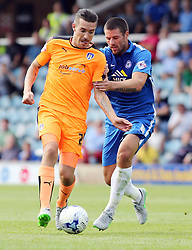 Colchester United's Darren Ambrose in action with Michael Bostwick of Peterborough United - Mandatory byline: Joe Dent/JMP - 07966386802 - 15/08/2015 - FOOTBALL - ABAX Stadium -Peterborough,England - Peterborough United v Colchester United - Sky Bet League One