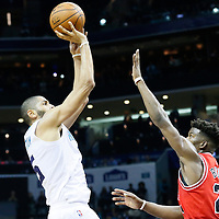 03 November 2015: Charlotte Hornets forward Nicolas Batum (5) takes a jump shot over Chicago Bulls guard Jimmy Butler (21) during the Charlotte Hornets  130-105 victory over the Chicago Bulls, at the Time Warner Cable Arena, in Charlotte, North Carolina, USA.
