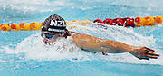 New Zealand's Moss Burmester in action in the mens 100m Butterfly Swimming Semi-Final at the Melbourne Sports and Aquatic centre at the XVIII Commonwealth Games, Melbourne, Australia, Sunday, March 19 2006. Photo: Michael Bradley/PHOTOSPORT<br /><br /><br />150328