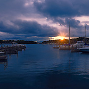 """""""Sunrise over Charlevoix""""<br /> <br /> Beautiful sunrise over the Charlevoix City Marina, in Charlevoix Michigan."""