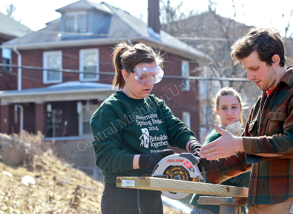 Jakki Peplinski, of Bay City, was among ten Central Michigan University students who spent their Alternative Break week volunteering with Rebuilding Together, an urban renewal experience, in Pittsburgh, PA. Their urban renewal experience gave them hands on experience working on homes and making repairs. Photo by Steve Jessmore/Central Michigan University