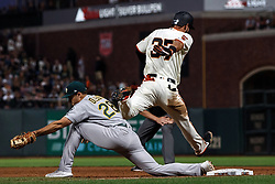 SAN FRANCISCO, CA - AUGUST 13: Joey Rickard #37 of the San Francisco Giants is forced out at first base by Matt Olson #28 of the Oakland Athletics during the sixth inning at Oracle Park on August 13, 2019 in San Francisco, California. The San Francisco Giants defeated the Oakland Athletics 3-2. (Photo by Jason O. Watson/Getty Images) *** Local Caption *** Joey Rickard; Matt Olson