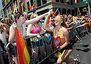 A Pride marcher with the Greater Fort Lauderdale Convention & Visitors Bureau greets crowds at the New York Gay Pride Parade, Sunday, June 29, 2014.   (Photo by Diane Bondareff/Invision for Greater Fort Lauderdale Convention & Visitors Bureau/AP Images)