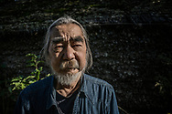 Kenichi Kawamura, who is half indigenous Ainu, the indigenous people of Hokkaido and manager of the Kawamura Kaneto Ainu Kinenkan museum.  Hokkaido was majority Ainu until the 19th century when the &quot;Wajin&quot; (Japanese) began penetrating northward from the southern tip of the island, first setting up trading posts.  Ainu men who wore long beards and were regarded by Japanese regarded as the hairiest people on earth.  Ainu women would tatoo their lips and around them black, not unlike Fulani women in Africa.  The Ainu were caricaturized in ukiyo-e wood block prints people living off the land with wild hair and brooding eyes.  <br /> <br /> Now, after a history not unlike the experiences of Native Americans in the United States, there are very few pure Ainu people left through intermarriage with the Japanese majority.  Kawamura-san is trying to honor, remember and record the heritage of the Ainu people.